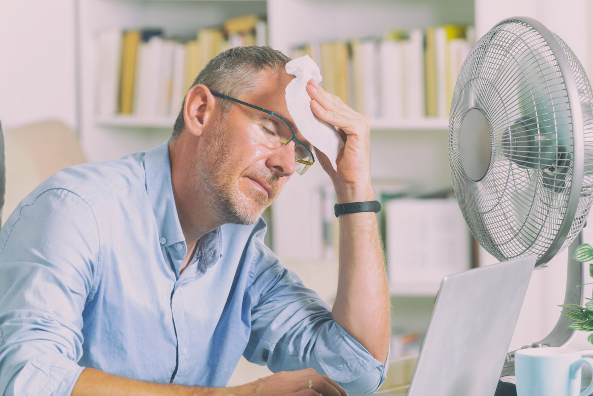 bigstock-Man-suffers-from-heat-while-wo-258274495-1200x801.jpg